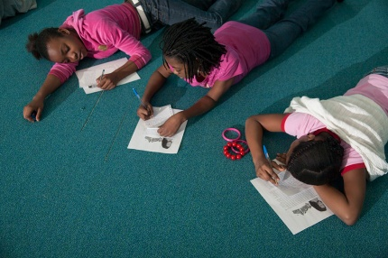 Students participate in the writing workshop.