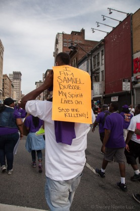 Residents of the Central Ward march down Market Street calling for an end to violence.